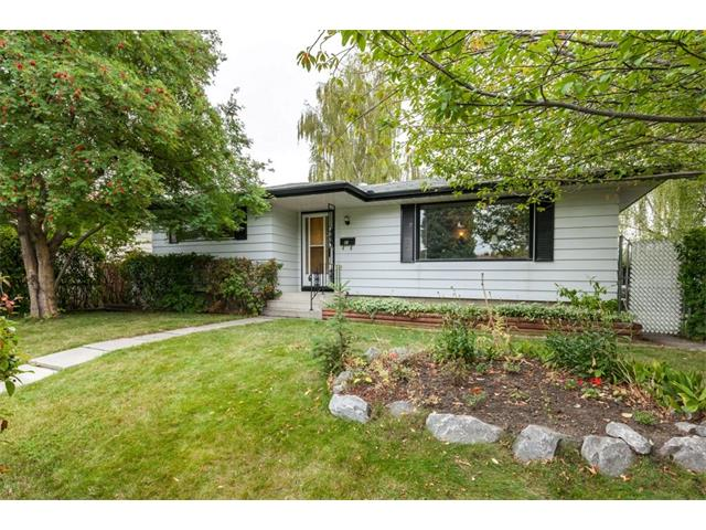 BEAUTIFUL & IMMACULATELY CARED FOR bungalow on a massive 67' x 110' lot, has over 2200 SQFT of living space on 2 levels, with 4 BDRMS and 2 BATHS.  UPGRADES include a professionally renovated new bathroom on the main floor, CENTRAL AIR CONDITIONING, newer roof/soffit/eavestrough and hot water tank, chain link PRIVACY fence, and new paint throughout. MAIN FLOOR: Spacious living room with built-ins and wood fireplace (hardwood under the carpet); dining area, large kitchen with eating area and bright south-facing window; gorgeous bathroom; large master bedroom plus 2 additional bedrooms. BASEMENT: SIDE ENTRANCE leads directly to the FULLY FINISHED BASEMENT complete with a huge recreation room with GAS FIREPLACE, bar and shuffleboard; there is a laundry/utility room; storage room with refrigerator & freezer; and a bedroom (without egress window). EXTERIOR: oversized/heated/insulated DOUBLE GARAGE, RV PARKING, paved back lane, SOUTH-FACING BACKYARD. CHECK OUT THE VIRTUAL TOUR!