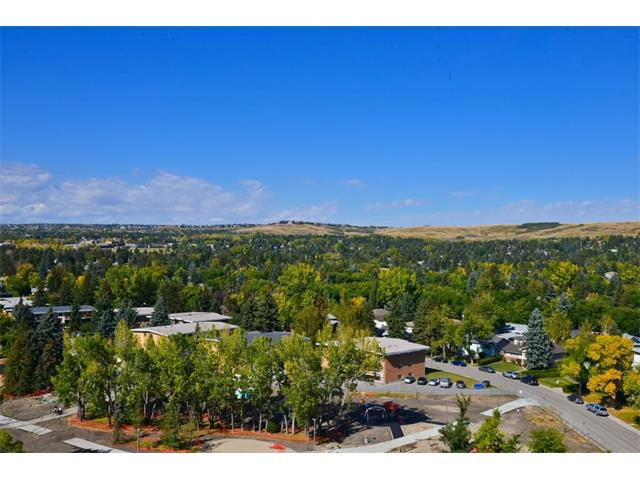 Outstanding University City unit!  Two bedroom, two bathroom corner unit with unobstructed views from every window (no looking into other buildings).  Walking distance to C Train, U of C, recreation facilities, shopping & restaurants.  Located on the 11th floor with sweeping views West to the mountains and North over Nose Hill park.  Great layout with two good sized bedrooms, two four piece baths (one ensuite) open concept living area with two sides of windows, L-shaped kitchen can accommodate a portable island or table.  Neutral color palette with crisp white cabinetry, grey toned countertops and wood look flooring.  Large windows in every room emphasize the views.  NW corner location points away from traffic of Crowchild.  In suite laundry, titled parking stall in heated parkade, and private storage unit.  Unit is currently rented with excellent tenants (photos are when the unit was vacant).  The Listing Agent has an interest in the property.  Viewings only M-F from 11 am to 6pm with 24 hours notice.