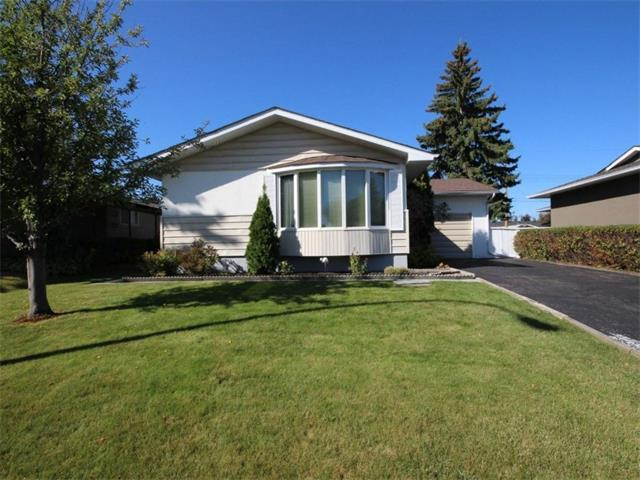 Great location! Well maintained 1085 sq. ft. bungalow located on a quiet street in prestigious Willow Park, backing west with a single attached garage, driveway for up to three vehicles and alley parking. This 3 bedroom home has 65 oz carpet (with original oak hardwood underneath) on the main floor, newer cabinets, jetted bathtub, water softener, water filter, vacuflo and sliding doors to large deck.  Finished lower level including large rec room with bar, 3 piece bath, laundry room, workbench and lots of storage.  Roof replaced in 2015. Outside: a low maintenance, landscaped yard. This home provides easy access to schools, playgrounds, bus stops, Trico Leisure Center, golf courses, public library, Italian Center, Superstore, Walmart, Southcentre mall, all kinds of shopping.  Deerfoot Trail & MacLeod Trail minutes away.  Less than a 14 minute walk to the Southland C-train station.