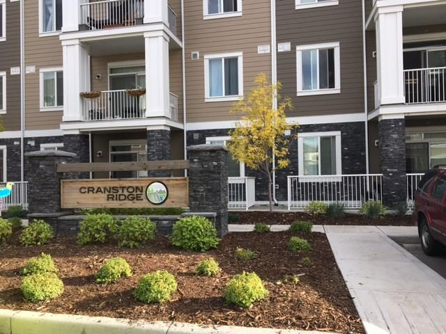 Attention Investors! This ground floor 2 bed 2 bath apartment  (a favorite plan at Cardel lifestyles) already has a lovely tenant in place! The titled above ground parking stall is easy to reach thru the patio doors. Located in the lovely community of Cranston it is Close to the new hospital and access to deerfoot trail. This pet friendly building  is just steps from the ridge leading to  fish creek park .