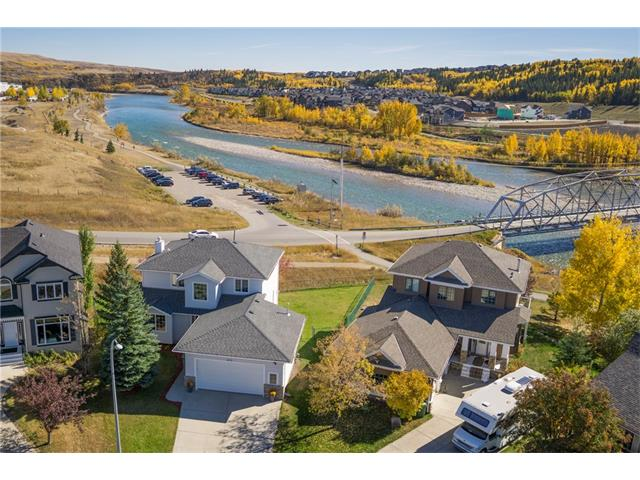 BEAUTIFUL WALK-OUT home w/over 2854 sq ft of living space on a HUGE 785 sq mt lot BACKING SE onto the BOW RIVER w/BREATHTAKING RIVER + VALLEY VIEWS, STUNNING RIVER BRIDGE (SUPER QUIET AS ONLY EMERGENCY ACCESS) WALKING PATHS, OFF LEASH DOG PARK + SUPER QUIET CUL-DE-SAC w/FRIENDLY NEIGHBOURS! QUICK 5 MIN WALK to the NEW Spray Lake Sawmills REC CENTRE + GOLF COURSE! Features you will LOVE inc FULL A/C, IN-FLOOR HEAT, GAS FIREPIT, 2 COZY GAS FIREPLACES, CLEAN + NEUTRAL DECOR, 2 NEWER H2O tanks + more! The SPACIOUS main floor has a SPACIOUS foyer, formal dining rm, LARGE laundry/mud rm, half bath + OPEN CONCEPT living rm w/CORNER GAS FIREPLACE + GORGEOUS kitchen w/CLEAN WHITE cabinetry, BIG island, GAS STOVE + OVEN, CORNER PANTRY + door leading to the HUGE DECK w/STUNNING VIEWS! Upstairs is a bathroom + 3 GOOD SIZED bedrooms inc the Master Suite w/WALK-IN closet + EN-SUITE w/SOAKER TUB! The FINISHED basement has a BIG family rm w/CORNER FIREPLACE, 4th BIG bedroom, bathroom + HUGE STORAGE area in utility rm!