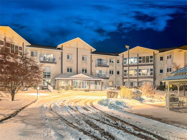 ONE of the LARGEST FLOOR PLANS available!!! Welcome to this BRIGHT+ SPACIOUS suite w/1351 sqft of developed living space in the BEAUTIFUL COURTYARD ESTATE of Strathmore! TONS of AMAZING feat incl ALL NEW WINDOWS + FURNACE, KNOCKDOWN CEILINGS, A/C, 9 ft CEILINGS, BIG SUN RM, HEATED underground parking + storage locker! Front FOYER w/CLOSET storage, leads into the BRIGHT WHITE kitchen w/matching BLACK appliances, TONS of COUNTER SPACE, GARBURATOR + raised BREAKFAST BAR! OPEN CONCEPT dinning + HUGE living rm can accommodate the whole family + features a corner GAS FP, PRIVATE OFFICE w/GLASS DOORS + your OWN PRIVATE SUN ROOM w/views of grounds + GAZEBO! LRG MASTER SUITE complete w/4 pc ENSUITE, LINEN + WALK-IN CLOSET! Another equally SPACIOUS 2nd bdrm w/closet, 3 pc bath across the hall + BIG Laundry rm w/CABINETS, SHELVING + FREEZER SPACE!! FANTASTIC AMENITIES incl: 2 large SOCIAL rms w/BILLIARDS POOL rm, GAZEBO, GYM, LIBRARY + even RV STORAGE!! CLOSE TO SHOPS + GOLFING! THIS UNIT WILL NOT LAST! VIEW NOW!!!