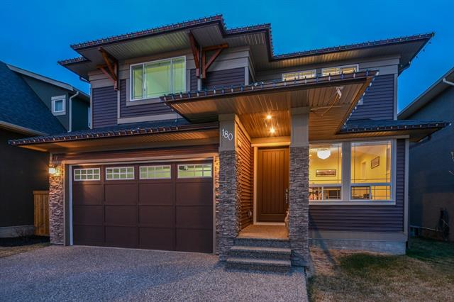 Introducing this exquisite home in the family oriented community of Kinniburgh, in Chestermere Lake - this property is found on a quiet street where kids are free to run and play. In addition to the ideal location for growing families, the property itself is nothing far from grand. With vaulted ceilings, floor to ceiling windows, a kitchen that would satisfy the greatest chef and/or biggest entertainer. This property is a 10/10 with it's beautiful unique features, enclosed with nothing but premium upgrades which will surely impress your guests. The living room features floor to ceiling windows, a gas fireplace with a grand shelving unit surrounding it and vaulted ceilings. Cast iron railings leading you up the stairs to find the spacious bonus room and the three bedrooms with all their own washrooms - saving the best for last? The master retreat, your own little oasis - this property is truly one you have to view for yourself - Call today to set up your private viewing!