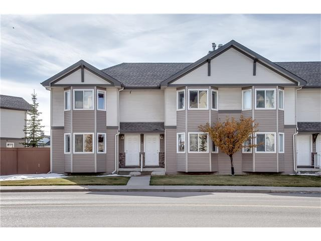 Large price reduction!  Best deal in the area.  Immaculate Royal Oak townhouse in one of the most convenient locations in the NW!  Quiet side street, yet just minutes to Stoney Trail, LRT, new recreational complex, shopping centre just two blocks away!  Lovely open plan with hardwood laminate flooring.  Spacious living room with full bay window and corner gas fireplace. Bright efficient kitchen/dining nook with south windows for plenty of natural light.  Honey maple cabinetry, sleek black appliances and a pantry closet for extra storage.  Main floor powder room.  Upstairs, the two large bedrooms each have a walk in closet and share a very clean, modern 4 piece bathroom (double doors provide access from either bedroom).   Sunny west facing deck off kitchen.  Fruit trees and hedges provide privacy.  Two assigned parking stalls just steps from the door, loads of visitor parking, as well.