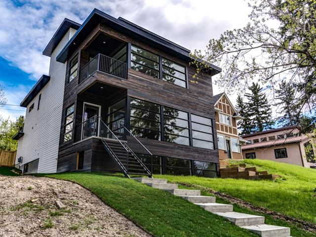**OPEN HOUSE - FRIDAY NOV 3 - CANCELLED DUE TO WEATHER** Absolutely stunning new home located in the inner city community of Elboya. This home offers about 6,000 sq ft of finished space. Oversized Lux windows take advantage of City Views from 3 levels. 9 to 11 ft ceilings throughout. The unique steel elevator is a great feature for seniors and entertainers alike. There are Brazilian cherry floors throughout common areas. Main floor kitchen offers Gaggenau Thermador & Bosch appliances with high gloss white German made cabinetry, quartz counters, huge island and bar fridge. The second floor has 4 generous size bedrooms. The master suite has a walk in closet & spa like ensuite with steam shower. There are a total of 5 bathrooms in this house with separately controlled in floor heating. The 3rd floor flex space has an additional kitchen/bar. There is a bedroom with sitting area, bathroom and large play/entertainment space on the lower level.  An additional parking space can be added if desired.