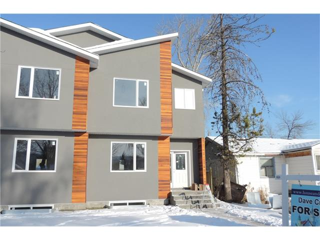 """Lowest priced new infill in Calgary over 1700 sq ft. As of Oct 11 all flooring is in. new pictures will be posted soon. Located in the well established community of Bowness and is close to transportation, all amenities and COP as well as a quick drive to the mountains . This wonderful 2 story home is located close to all amenities including step from an elementary school and short walk to jr. and sr. high school. The home is just being finished and will be ready around mid October. If this house was measured as a single family home it would be 2030 sq.ft. $6,500 appliance pkg and that is wholesale not retail is included and fencing and landscaping is included. This is one of those rare infills with a bonus room. you will love the 2 1/2"""" quartz countertops in the kitchen. Quiet location and close to all  amenities including public transit, this is an amazing home. Rec room has a wonderful wet bar and a place to put your 150 inch tv. Please ask for a sample list of appliances."""
