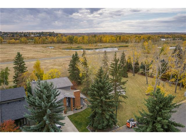 GORGEOUS home in the ESTATES of DEER RUN w/over 3356 sq ft of developed living space, BACKING onto a GREEN SPACE, STEPS 2 PLAYGROUND + FISH CREEK PARK w/VIEWS of the VALLEY + RIVER, BIKE PATHS + PRIVATE FISHING ON THE BOW!!! AMAZING feat incl NEWER H2O TANK, NEW NEUTRAL PAINT, NEW BLINDS, VAULTED CEILINGS, TREATED GARAGE FLR w/WORKSHOP, 3 GREAT PATIOS; 1 WRAP AROUND, 1 COVERED + 1 W/FIREPIT, UNGRD SPRINKLERS, OUTDOOR SINK, SECURITY LIGHTS, SHED, GREENHOUSE + more! GRAND foyer feat SOARING WOOD PANELED CEILING, step-down living rm w/CORK FLR, NATURAL STONE FP + LOVELY dining rm w/sliding drs! BRIGHT kitchen w/OAK TRIM + CABINETS, NEW CAESARSTONE + BFAST nook, BIG family rm w/BUILT-IN's, WET BAR, BRICK FP w/gas start, LAUNDRY + 2 pc bath finish the main. STUNNING WOOD SPINDLED stairs lead to a BUILT-IN LIBRARY, 4pc bath + 4 GOOD size bdrms, incl the MASTER bdrm w/LRG CLOSET + 3 pc EN-SUITE w/STONE TILED SHWR + CABINETS. FINISHED bsmt w/LARGE family + rec rm, 3pc bath, UTILITY + FLEX rm! COME VIEW TODAY!!!