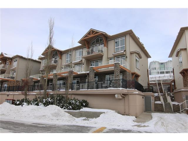 Only a 10 minute walk to the LRT & leisurely stroll to the Rocky Ridge Co-op Centre is this lovely 1 bedroom townhome in Blue Sky...Streetside Developments' highly sought-after condo project surrounded by winding greenbelts & walking paths in this popular Northwest community.  With soaring 9ft ceilings & infloor heating, this spacious unit boasts a super open concept layout complemented by warm neutral decor, 2 patios & titled parking stall for your exclusive use.  Smashing Southwest-facing living room with floor-to-ceiling windows, separate dining room or home office & maple kitchen with raised bar, tile floors & white appliances.  The bedroom is a great size & enjoys a walk-in closet & garden doors to the patio.  The full bath also has tile floors & relaxing tub/shower combo & is next to the insuite laundry complete with washer & dryer.