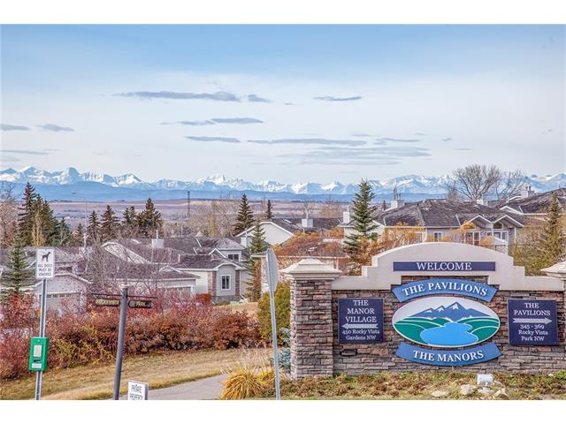 Located in the sought community of Rocky Ridge, it offers the open south view with Rocky Mountain at the background, and a few minutes walk to the LRT Tuscany station. Nice water features welcoming you to the Pavilions apartment building, with security door, access ramp and elevator to room and underground parking. Master bedroom has an en-suite bathroom and walk-in closet, plus a second bedroom and second 4pc bathroom. Good kitchen space features maplewood cabinets, with raised breakfast bar. A gas fire place in the living room and a side access to the balcony. Ample visitor parking spots. HOA provides the access to The Lake Club where has theatre, game room, large activity area, fitness, cafe and beauty shop. Come and check it out!