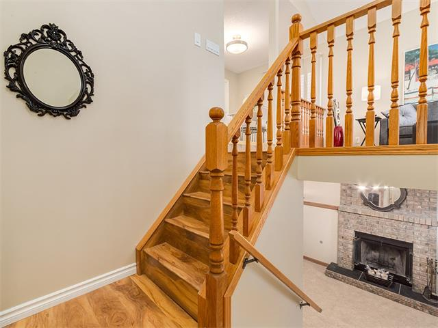 Most affordable home in Shawnessy! This 4 bdrm home is situated in a cul-de-sac w/great access to public transit, shopping & you'll even find a tennis court & park just a few doors down. This affordable home has been repainted w/new carpeting in bedrooms & basement. Upstairs features a light filled living room w/bay window & beautiful laminate floor. Eat in kitchen boasts oak cabinetry, tile backsplash/floor, black appliances & pantry. A sliding patio door gives you access to the backyard, it's a great layout for entertaining. A massive master bdrm w/dbl closets feels like a spa retreat w/large soaking tub. A 2nd bedroom & 4 pc bath complete the floor. You'll find all new lighting & Hunter Douglas blinds thru-out. Lower level offers a family room w/wood burning FP & built-in cabinetry along w/2 more bedrooms, spacious laundry area w/tankless hot water system, under stair storage space & walk up access to fully landscaped/fenced yard w/dog run & house, shed & firepit. Come see your new home today!