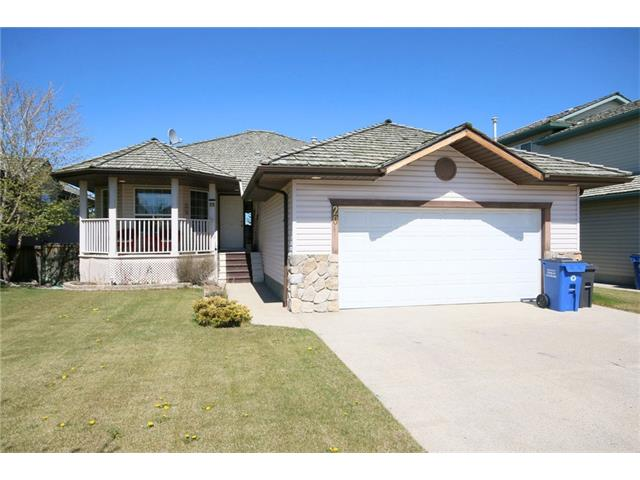 This walkout bungalow is fully finished and ideally located, backing onto trees and the river beyond. With no rear neighbours, the peacefulness of the yard and deck is sure to please all year round. The front entry is bright and spacious, leading to the formal dining room or the living room with vaulted ceiling and fireplace. The kitchen is nicely laid out and features a corner pantry, plenty of counter space, and loads of natural light. The main floor has 2 bedrooms including the master with a full ensuite, oversized tub, and walk in closet. There's another full bathroom plus laundry room on the main floor. The breakfast nook area features a patio door to the deck, or you can access the deck from the master bedroom. The lower walkout level is fully finished with a second fireplace, huge rec room, 2 more bedrooms, another full bathroom with dual sinks, and tons of storage space. This home is definitely worth a look.