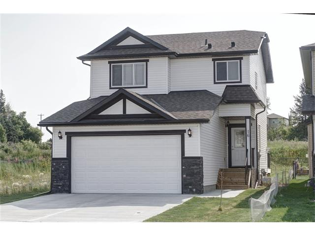 "The seller is offering a $1,000 BONUS TO THE BUYER in the form of a VISA gift card upon closing! Only 45 mins East of Calgary, this home is priced to sell & offers all the modern finishes you could dream of! Open concept plan, 9' ceilings, tiled corner gas fireplace, upgraded Moen faucets & light fixtures to name a few. The chef's kitchen will be a delight to cook in boasting 36"" cabinets for extra storage, quartz counters, stainless appliances, & centre island. Upstairs, the master retreat offers a walk-in closet and 5 piece spa-like ensuite, complete with dual sinks, jetted tub, and separate shower. Two generous sized bedrooms & separate 4 piece bath complete this level. The basement awaits your personal touch & is roughed in for a bathroom development. Here, the water supply for the state-of-the-art home fire sprinkler system, aesthetically designed & provides piece of mind in protecting your new home. Now is the time to get into a new home without having to pay GST; immediate possession available!"