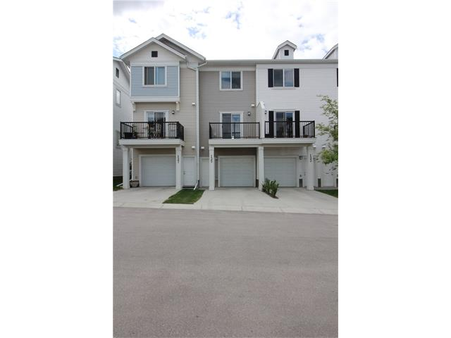 Very stylish, contemporary, open floor plan 3 storey townhouse located in the community of Silverado SW. Featuring 9'ceilings on the main floor with wood floors. Single attached garage with lots of storage area.  Lower floor has a den with a half bathroom.  On the main floor, open concept floor plan give you lots of natural sun-light.  In the Kitchen, there is a trendy modern cabinets with central island. Upper floor you will fine all the bedrooms and bathrooms. Master suite including an ensuite and a walk-in closet. Ample storage in the single attached garage and you can park 1 car on your driveway.  Close access to Stoney Trail and Deerfoot Trail. Just minutes to an abundance of amenities such as shopping and restaurants! Good investment property for either you move in or rent it out! Please call now and book a viewing! Shows 9.5/10!