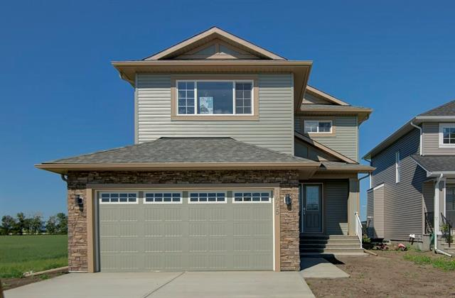 Brand new quality built Ishaan home has an exceptional view to the west overlooking farmland and with a sweeping panorama of the mountains. It has beautiful finishes with hardwood floors, tiled entryway and bathrooms, quartz counter tops in the kitchens and all bathrooms, 9' ceilings and 8' doors on the main floor, and excellent cabinetry and millwork. The floor plan is designed for a family with a spacious front entryway, large open plan kitchen living and dining and kitchen opening onto a west facing deck, and a 11' x 11' office flex room on the main floor. Upstairs there are three bedrooms including a master with double sinks, separate shower and bathtub, and an oversize walk-in closet. There is also a 15' x 12 bonus room back and a walk-in laundry room.  This home has a great location close to shopping downtown High River and walking distance to the Snodgrass recreation centre.