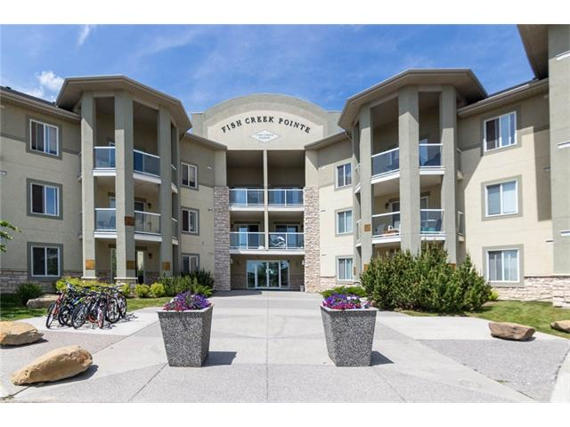 Amazing Panoramic views of downtown & Fish Creek! This large 2 bedroom, 2 bathroom top floor unit is the perfect condominium for first time buyers and young families. The two bedrooms are on separate sides, perfect for room-mates to share. The large master bedroom has a walk-in closet and ensuite, second bedroom is fair size, large living room has patio door leading onto a private balcony to enjoy with friends and family. The functional kitchen has lots of cupboards, pantry, black appliances, island, and eating area has lots of counter space and storage. In-suite laundry, with good management and condo fees that include all heat / water / gas and electricity and building insurance. One of the few units with 2 parking stalls (1 underground & 1 exterior stall, and storage locker). Conveniently located close to schools, public transit, shopping and major road ways for an easy commute. Call to view today!