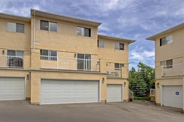 Price reduced $30K! Great value! This modern and bright 4-level split townhouse is a 5-min walk to the C-train station, shopping, Fish Creek park, all levels of schools & golf course. Spacious and very well kept & shows pride of ownership. Move-in ready! Perfect for the growing family or young professionals. Features 3 bedrooms, 2.5 bathrooms with DOUBLE ATTACHED garage. The Main floor has a 12' ceiling w/ ceiling fan, corner gas fireplace with mantle, bay window. Hardwood flooring on the main and second level. Large kitchen with generous dining area and sliding door leading to a huge south-facing deck. Upstairs features a master bedroom with walk-in closet & ensuite, another two spacious bedrooms and a 4pc washroom. Condo fees include cable TV as stated by the condo board. Need more storage space? Loads of room under the crawl space. Well managed and quiet complex! Size shown is RMS paint to paint. Exterior area above grade is 1429 sq.ft. Call to book your showing today!