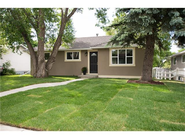 OPEN HOUSE SUNDAY DEC 3RD FROM 1-3 PM. Completely renovated bungalow nestled on a quiet street. Great curb appeal with brand new stucco, fresh sod, new rubber roof and all new windows!! Move in ready home with a 2 bedroom mother in law suite (illegal) in the basement perfect for guests or extra revenue. Upstairs you will find a bright living space with an open concept kitchen. New dark stained cabinetry with brand new stainless steel appliances for the new home owner to enjoy! Laminate flooring throughout the entire home including the 3 bedrooms on the main floor. New bathroom vanity, toilet and tubs in both 4 piece bathrooms! This charming lot has beautiful mature trees to provide extra privacy! Extra large double attached garage accessed through the back lane. Yes, you read right, HUGE ATTACHED GARAGE with a brand new concrete pad connected from the basement utility area. Enjoy your patio with your south facing backyard!! Great investment property with tons of potential to live in or rent out!!