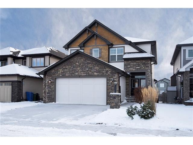 Masses of curb appeal with this fabulous former showhome in a cul-de-sac in Cimarron Springs, close to Okotoks? best shopping. Immaculate & upgrades galore. Spacious tiled entrance leads to a huge dining room with hardwood flooring. Beyond lies a super kitchen with masses of soft close & extended height cabinetry, pot & pan drawers, quartz countertops & stainless steel appliances. The cabinetry continues into the large breakfast nook. The cozy living room has a beautiful gas fireplace. You?ll love the private main floor den, with built ins & also the cubbies & walk in coat closet by the oversized garage. 9? upper level ceilings! The central bonus room has a 10? tray ceiling, a feature echoed in the master, which also has a sumptuous 5 pc en-suite & a terrific walk in closet with a door to the laundry room. The large 2nd & 3rd bedrooms share the 4 pc family bathroom. Air conditioning. Landscaped, southerly rear yard with a deck & a sprinkler system. COME VIEW THE 3D TOUR NOW - click the Multimedia Button!