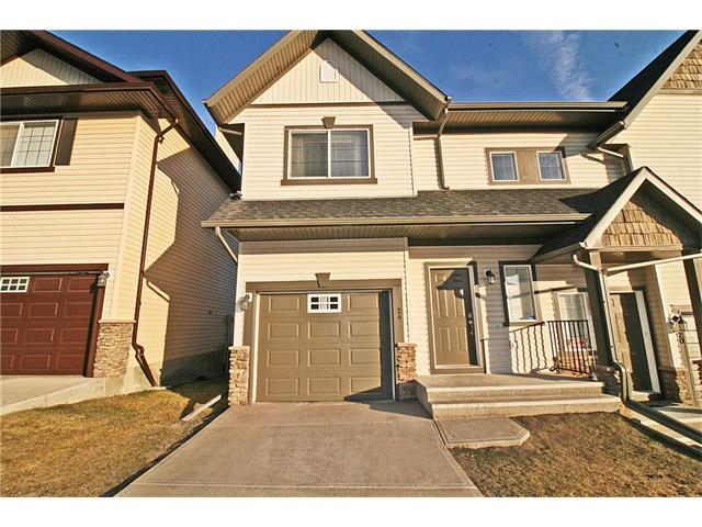 A gorgeous, former show town home, backing onto a quiet green space, located in desirable Rockyridge, yet only 25 mins from down town Calgary on 1A, close to Rockyridge/Tuscany LRT station and mins away from all amenities including the new Rockyridge YMCA!. This home offers peace, tranquility, views of nature and convenience! 3 good sized bedrooms, 2 and a half bathrooms, a cosy living room with a gas fireplace, a functional kitchen, ceramic tile and carpet  flooring, a nice sized deck and an attached garage complete this classy gem! A must see!