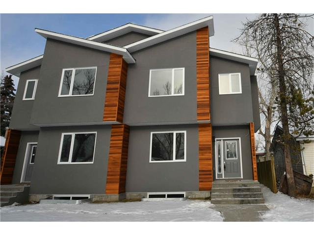 "Move in ready.  Lowest priced new infill in Calgary over 1700 sq ft. If it was measured as a single family home it would be 2,030 sq ft. This is the perfect family home. Located within walking distance to all amenities including schools and a short drive out to Banff. You will love the 2 1/2"" quartz counter-tops in the kitchen, the lighting and the island. The spacious main level has laminate floors, a bonus room, a wonderful cozy gas fireplace in the living room with built in shelves. All the bedrooms are decent sized and the en-suite is amazing. The rec-room has a wonderful wet bar and a place to put your 150 inch television. Both sides are still available."