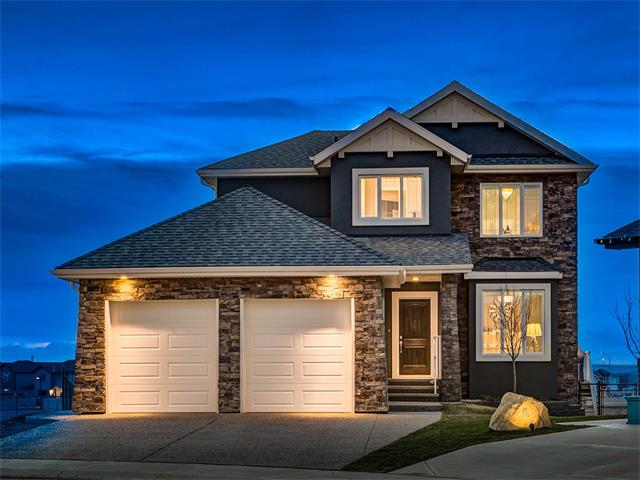 "IMMACULATE ""LIKE-NEW"" home w/OVER 3733 sq ft located on a QUIET CUL-DE-SAC + HUGE 719 sqmt SW FACING LOT, backing onto WALKING PATHS + MOUNTAIN VIEWS! Fully UPGRADED w/CURVED O/R Staircase, Main Flr Office, 1/2 bath, HUGE Mud rm w/Built-in's, AMAZING Kitchen w/2-Tone Cabinets, GLASS tile b/splash, HIGH-END S.S. APPL's incl GAS Stove, BAR Fridge, HUGE QUARTZ Island, DESIGNER Pendant Lighting,  9' KNOCK DOWN CEILINGS, LRG TRIPLE PANE Windows, WIDE PLANK Hardwood, Spacious Living rm w/STONE GAS F/P, CUSTOM BUILT-IN's, a BRIGHT Dining area w/access to the RAISED DECK w/GAS LINE to BBQ w/MOUNTAIN Vw's ! Upstairs is a BONUS rm, 2 Generous Bdrm's w/W.I.C's, 5pc bath, LAUNDRY w/cabinets, MASTER w/LUXURY 5pc EN-SUITE w/SOAKER TUB, RAIN SHWR + W.I.C! FIN bsmt is WIRED for SOUND, LGE FAMILY rm, 2 add'l Bdrm's + 4pc bath w/IN-FLR HEAT! HIGH EFF FURNACE, 63 GAL H2O TANK, Heat Recovery FRESH-AIR Ventilator, A/C, Udgd SPRINKLERS, OSMOSIS R/I, O-SIZE GARAGE w/AGG Drive + MORE!  This is the ""ONE"" you've been DREAMING OF!"