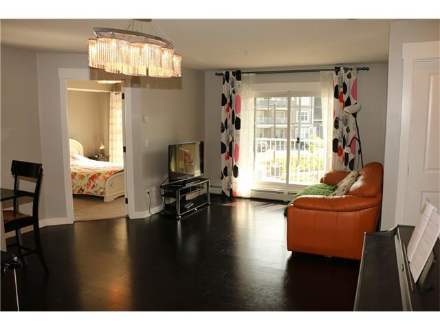 Located in the sought after community of  Mahogany. Stunning ! 2 Bdrm+Den Condo 2 full baths.  This is a great opportunity to own a home that is  just minutes from the West Beach. South facing balcony with BBQ gas line. Dark rich cork floors, Granite kitchen counters with pots and pan drawer. Large pantry, over the range microwave. Stainless steel appliances, upgraded lighting package, Rough in garburator. The master bedroom features a full bath with granite counters, his and her closets. Good size second bedroom with walk-in closet.  Steps to preschool, restaurants  shopping and bus. In-suite laundry with front loading washer and dryer. Building offers elevator security cameras and a storage locker. 1 parking stall Underground. Award winning Community features 2 beaches and a 74 acre wetlands with 22 km of pathways. Great for biking walking and jogging. Enjoy the 2 Beaches for fishing, swimming, or just to relax In the warm sun