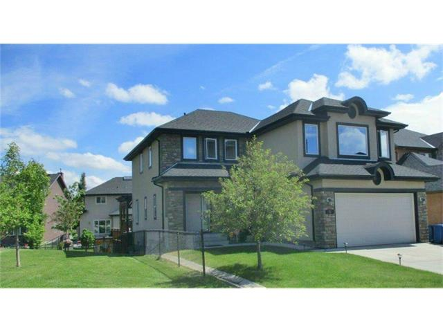 Spectacular location in the executive community of Aspen Woods! Siding onto a playground, this 2-storey home showcases over 3,500 sq. ft. of versatile living space on 3 levels.  The main floor is bright featuring a formal dining room, cozy great room with gas fireplace, a private office/den, a stunning kitchen with plenty of storage and counter space. The upper floor 3 bedrooms are spacious and complimented by the entertainment-sized bonus/media room with state-of-the-art blackout motorized blinds on all windows. The lower level is fully finished with a 4th bedroom, full bathroom, family room, wet bar and games area. The 3-tier deck overlooking the playground and backyard is a rare find. Close to some of the finest public and separate schools in Calgary.