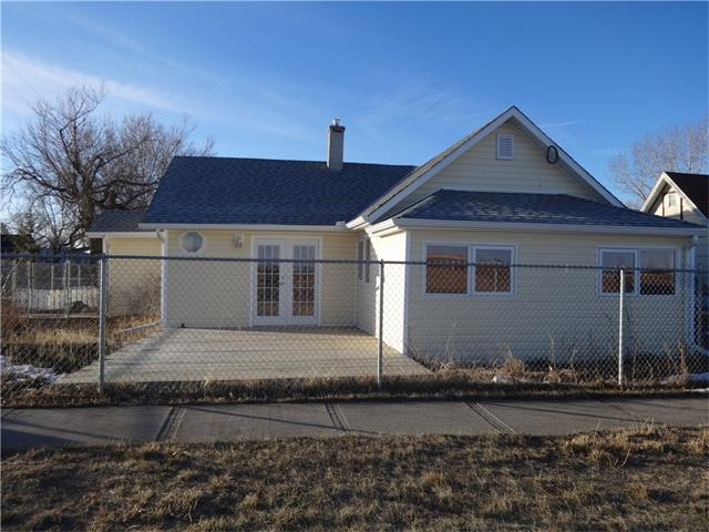 Wow, this wonderful bungalow has numerous upgrades and shows great. Included in the 1036 sq ft you will find a nice size kitchen, featuring brand new fridge and stove, loads of cupboard space and garden doors to the deck. A large living room with good size windows for natural light and the wall has been renovated to secure a big screen tv. Two bedrooms and the bath contains a fabulous claw tub for you pleasure. The TLC shines through and it wont disappoint you. Outside you can enjoy the 14 x 19 ft deck directly off the kitchen to relax in the sunshine or BBQ your dinner. The corner lot has all of its own bonuses, like extra parking and no direct neighbour on that side. But the garage.....a  triple detached, 220 wiring, heated and insulated. The single door has a side mount garage door opener to make use of either a car lift or all the storage offered above. A built in fire pit and a large shed complete the exterior of this home. Upgrades include: furnace 2010, hot water tank 2010, siding & roof 2013,