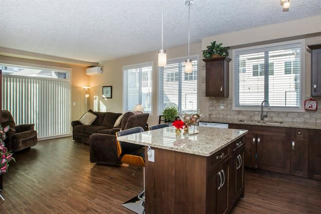 OPEN HOUSE SAT MAY 5 1-4PM. Priced to sell and cheaper than new! This is a gorgeous main floor walk out corner unit chosen for its privacy and quiet location in the complex, with over $26,000 worth of upgrades! To mention a few ? extra sound proofing, air conditioning, upgraded luxury vinyl plank flooring, granite counters, - check the full list when you view the unit. It has 2 bedrooms, 2 baths and heated underground parking with additional storage unit. The main bath has a walk in shower and the ensuite has a separate shower and tub. Both have full height tiles and back splash. Located in the Cardel Cranston Ridge project this unit is well built, with cement fiber siding and  their award winning ventilation system, sound attenuation system, 9? ceilings and 8? patio doors with transom above.  The visitor parking is just steps from the patio door and It is located just a short walk to beautiful walking and biking paths at the ridge overlooking Bow River and Fish Creek Park. Also...