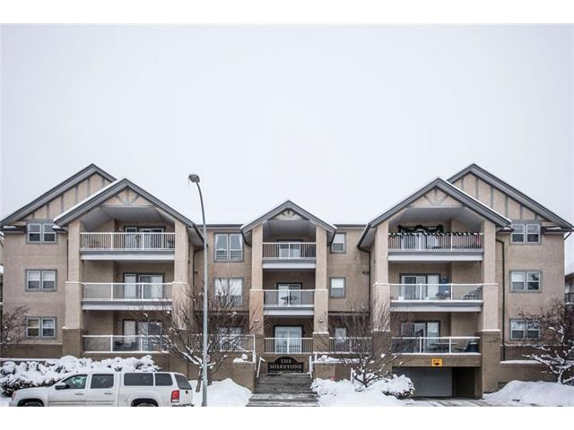 Here is your chance to customize this spacious top floor condo and CREATE MASSIVE value. Located on the back of the building makes it a VERY quiet unit. Great layout offers 1100 sqft of living space, vaulted ceilings, open living room with cozy corner fireplace, large kitchen finished with white cabinets, breakfast bar, pantry and Great Cupboard and Counterspace, 2 bedrooms and 2 baths. The oversized master bedroom includes walk-in closet and 3pc ensuite with a large walk-in shower. Other great features include in-suite laundry conveniently located in the hallway close to the bedrooms, large Private balcony you can access from the living room and both bedrooms, comfortable in-floor heating system and titled heated underground parking stall. PERFECT Location with Easy Access to Major Roadways, shopping, library, theatre, Restaurants, recreation centre and short walk to the c-train. LAKE ACCESS is included in the condo fees!! Some cosmetic work needed. Call now to add value and build equity!