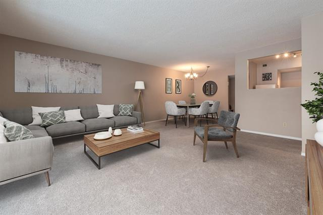 """Priced to sell! 1,110 sq ft 3-bedroom home in a quiet concrete building. Save on payments & leave your car at home ? less than 10 min walk to Heritage LRT, Shoppers, and Co-op. Kitchen has new appliances and in-suite laundry over laminate floors & opens to the dining/living areas. Enormous 17?x13? living rm with patio access has room for your sectional to watch the big game, and an at-home work space. Master bed features 2-pc ensuite and wall-to-wall closet to organize your wardrobe. 3rd bed is great flex space to use as your den, storage, or bicycle repair room. Enjoy the convenience and flexibility of single-level living ? parking & entrance all at grade level. Separated from Heritage Dr by a large tranquil greenspace, this 25+ building has recent updates including railings, roof, and siding. Despite the """"No Rentals"""" sign, rentals are allowed. Don?t miss out on this great value with huge potential ? Call today!"""