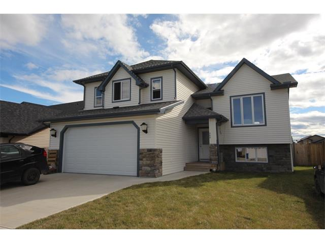 If you looking for an Attractive 5 Bedroom Home then Come and view today. Enjoy this Newer Home with many options and extras, Fenced yard, Large South Facing back yard with upper and lower decks, with gas BBQ hook up and wired for hot tub, Front attached Double Garage. HOME IS detailed with Natural Hardwood flooring, KITCHEN WITH Hardwood cabinets and Large Island. Beautiful 3 side gas fireplace between living and Dining Room. 2 Full Baths and a full 4 pc bath ensuite off the Large Master Bedroom. Enjoy the option of Laundry Hook Up either up or down,In-concrete floor Heating in Basement , Plus High efficiency forced AIR for the home. This Home is located in a desirable Neighbourhood, Backs onto a large Park area