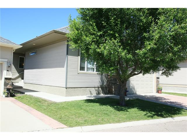 OPEN HOUSE SAT FEB 10th  2 to 4 pm  MAINTENANCE FREE LIVING IN AN OUTSTANDING LOCATION!! View of the Bow River from this well maintained bungalow in Crawford Ranch just steps from the walking path. A unique community at the junction of the Bow River & Jumping Pound Creek. This home features a nice open concept on the main floor with a gas fireplace in the great room, convenient laundry room, a spacious master with a 4pc ensuite & 2nd bedroom & 3pc bathroom. Corian counters and Oak Cabinetry in the kitchen with a separate dining area.  In-floor heat under the laminate on the lower level finished with a huge family and games area, additional bedroom & bathroom. Plenty of room for storage as well in the basement.  The double attached garage has opener & controls.  This is a much sought after neighbourhood - quiet, picturesque with all the outdoor maintenance, snow removal, landscaping included.  Easy to maintain and worry free when you travel. Don't miss out on this gem!