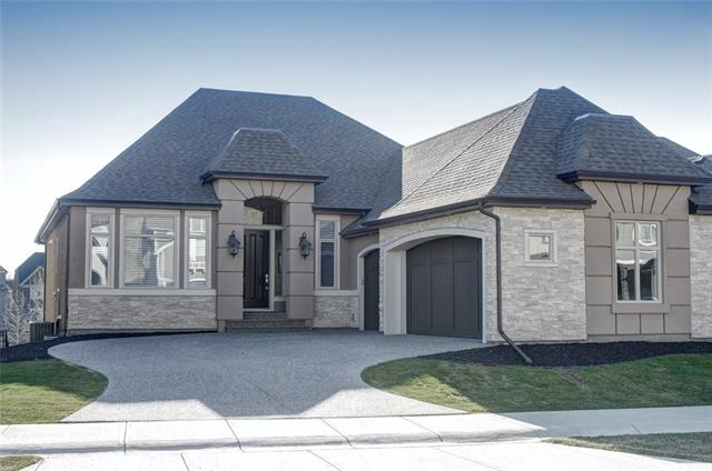 """Beautiful Riverstone Bungalow 2250 sqft  plus 1970 sqft walkout space. Great attention to detail and plotted on a choice lot on the widest part of the green space leading to the Bow River. Elegant finishing?s are showcased thru-out this thoughtfully DESIGNED home w/over 4000 sqft of elegant living space. Gourmet kitchen, walk-thru butlers pantry, 36"""" Viking cook top, Fisher&Paykel built in fridge & high-end Stainless Steel appliances. The large dining room connects to the butler's pantry & the nook w/large windows leads onto the south facing deck with covered roof. The large masters' retreat & luxurious spa-like ensuite exude comfort & opulence. The main floor office/music room complete the upper level. The lower level is tastefully developed w/2 spacious bedrooms, 4pc bath, media, & entertainment wall & large windows encompassing the beautiful outdoors. Triple side drive garage, $200,000 plus in upgrades and more will make you never want to leave! Come enjoy Riverstone today!"""