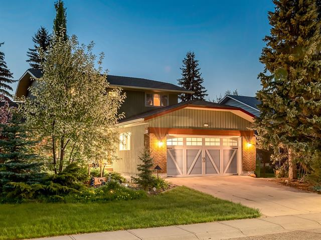 GORGEOUS UPDATED ESTATE home w/OVER 1817 sqft on a HUGE 658 sq mt CORNER LOT w/MATURE TREES, BIG YARD + STEPS from FISH CREEK PARK!!! OVER $160K in UPDATES + RENO?s incl: NEWER ROOF w/40 yr GUARANTEE, REFRESHED EXT PAINT, DOUBLE ATTACHED GARAGE w/EPOXY FINISHED FLR + WORKSHOP, SHED, NEW KITCHEN CABINETS, CORK + HWOOD FLRs, POT LIGHTS, KNOCKDOWN CEILINGS + MORE! SPACIOUS foyer opens to SUNNY Living rm w/BUILT-IN BENCH + LRG BAY WINDDOW, 2pc bath, COZY FAMILY rm w/BRICK WOOD BURNING F/P + Gas Starter, WAINSCOTTING, access 2 REAR DECK + GORGEOUS YARD w/varied FRUIT TREES + GARDEN! PROF RENO?d KITCHEN w/CREAM CABINETS, UNDER-LIGHTING, BUILT-IN HIDE-A-WAY Fridge, NEWER S.S. APPL?s, GARBORATOR, BFAST NOOK, + DUAL ACCESS to SIDE DECK from STAIN GLASS Dr + Dining rm FRENCH Dr?s! Upstairs is a 4pc bath + 4 BDRM?s incl the MASTER w/VIEWS of FISH CREEK, DUAL closet?s + 4pc ENSUITE! BSMT w/COLD RM?s, R/I for F/P + LAUNDRY rm w/SINK, STORAGE + illegal Kitchen! PRIVATE + PEACEFUL AREA close to PARKS, PATHS + AMENITIES!