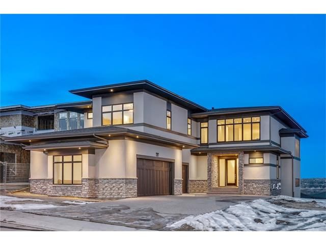 """SPECTACULAR LOCATION PERCHED ON PATTERSON HILL with 180 DEGREE VIEWS! ELEGANT MODERN DESIGN WITH OVER 5,000 SQ FT - 4 CAR GARAGE (EXTRA BAY- Shop, toys or another car)! WALK OUT! LOADED!!  The main features 10' & 20' ceilings with (9' upper & bsmnt), coffered ceilings, 6"""" baseboards, beautiful trim everywhere, built in details, lots of stone, den off the kitchen with views. Also on the main living room complete with FP & custom built-ins and large dining area. Your kitchen has all the cabinets you could want, built in appliance package including gas cooktop and a large butlers pantry. Upstairs are 4 bedrooms, 3 baths, laundry and a loft style bonus room w built-ins & loads of light! Your master suite is perfect, with a large dressing room, the ensuite has a custom tile shower, peninsula tub, heated floors fireplace & more. The lower level is finished with wet bar, huge family room, gym, cold room, built ins, roughed-in in floor heating & another bdrm!"""