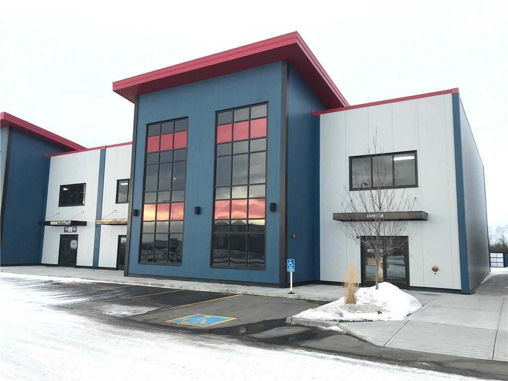 Brand new industrial office/warehouse condo unit in Airdrie's Gateway Business Park. Available size 2200 sq ft. Rent is $14 escalating. Average Operating Costs $6.50 PSF Incl: owner's insurance, property taxes, exterior maintenance, garbage removal, snow removal and grass cutting. The Paved Parking is first come first serve and illuminated. Overhead doors 12 x 15. Parking: Interior Height of building: approx. 22-25 ft. Site: The building was designed for second floor or mezzanine development. The signage can be located on the front storefronts or illuminated 3D above the front entry metal framing. DC-27-A Zoning offers many different business opportunities within the complex.