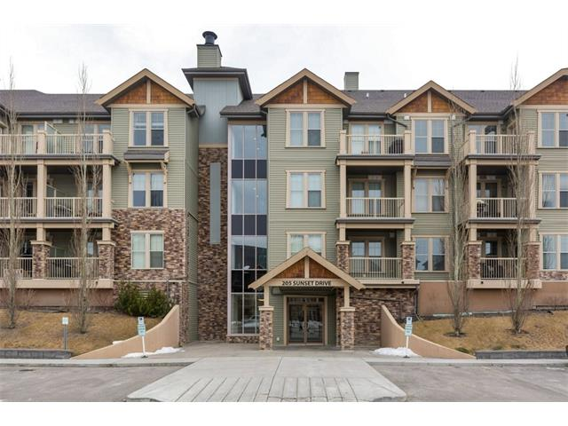 Cochrane - 2009 built TOP FLOOR 2 Bedroom suite in IMMACULATE condition.  2 TITLED parking stalls, 1 underground and 1 surface and separate storage unit too. Easy escapes to the mountains and busy Calgary lifestyles. Smartly laid out w/ a very functional Kitchen & good cupboard space, stainless steel appliances and breakfast bar.  Dining area can accommodate a good sized table and leads to a spacious living room.  The Master Bedroom is large and includes walk-in closet.  Across the hall is a 4 pc bath with separate shower and soaker tub.  The second bedroom (currently being used as an office) is a good size with the in suite laundry across the hall.  An office/den area and in-suite storage complete the layout.  Gas bbq line to the spacious deck with nice valley views.  Complex includes a Gym and Guest Suites are available to rent. Enjoy the quieter lifestyle of Cochrane.
