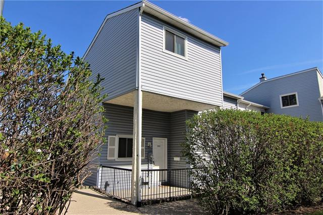 OPEN HOUSE Sun 12-3pm***PRICE REDUCED! Location, location, location! Close to all amenities, parks, public transportation, schools. This two story townhouse has a lot to offer. Walk into a large landing to a spacious living & dining room combination. Kitchen is very functional with tons of cabinets. Upstairs to a fully renovated 4 pce bath. There are two spacious bedrooms on this level. a few stairs up to a large bedroom on the top level. Basement is undeveloped with newer furnace and hot water tank. Newer windows throughout. assigned parking in back. Fully fenced back yard with patio door to the yard. A must to see!
