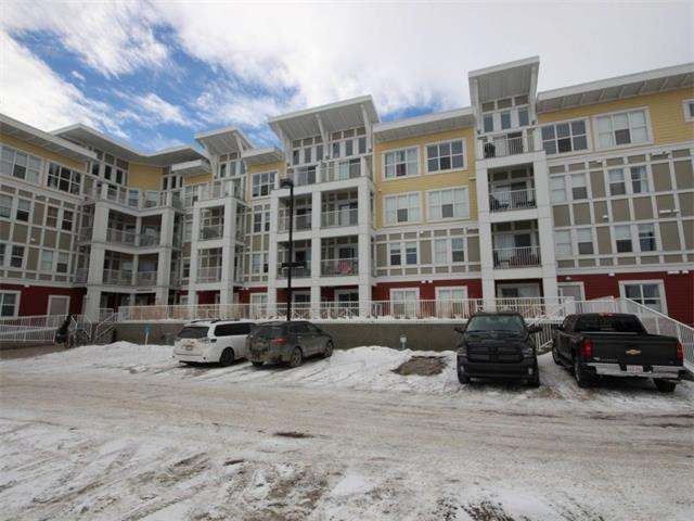 1 bedroom plus den spacious unit located at Ebony in Mahogany, one of Calgary's top communities. Live near Calgary's largest lake within walking distance to the numerous facilities and activities the community has to offer. The floor plan features a large upgraded kitchen with granite counter tops and stainless steel appliances, and a utility/storage room with upgraded front loading washer and dryer. The living room opens up to a large west facing balcony with plenty of sunshine and a view of the large green space across the street. The bedroom and den are generous sizes with full closets, with the den used as a second bedroom. The 4-piece bathroom is equipped with granite counter tops and upgraded tile. The unit has 9 ft ceilings. Six appliances are included, as well as window coverings in the bedroom and a portable AC unit. The unit comes with a titled parking stall and storage locker.