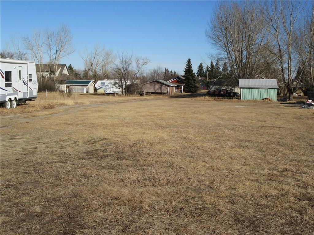 1.14 acres located in the Town of Nanton ready to be developed.  Frontage off 26th Avenue is 50' wide, servicing is located here.  The north lot line is 660' deep.  Use the front 50' x 374' as a lane way and build in the back 108' x 285'.  Seller will clean up the back of the property prior to possession.  The garage on the front 50' x 274' encroaches approximately 4' onto the neighbouring property to the south.