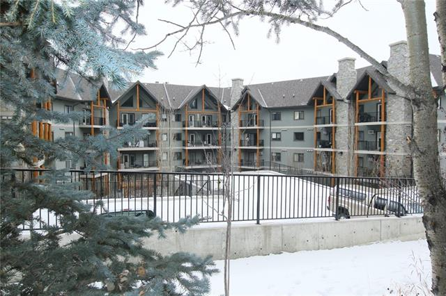 **  OPEN HOUSE, Sunday, March 18th, 1-3 PM  **  High end 45 plus condo complex in Cochrane is a great place to call home. This luxurious apartment has soaring ceilings,Great kitchen with granite counters,tall cabinets & center island,insuite laundry,upper loft area with new carpet is great for Tv room,reading room or a temporary sleeping area. The master bedroom is a good size with 9 ft ceilings,built in California closet system,full ensuite with separate tub & shower. The living & dining area with the vaulted ceilings get lots of natural light in the afternoon & create a great living space. The deck faces SW & has a storage cabinet. The building also has an exercise room, guest suite, family room area, library & puzzle room. Lower floor has the TV room, billiards & shuffle board areas,a rentable kitchen & dining area for family get togethers. The underground parking stall also has a storage cabinet at the end & there is a car wash stall below also. Check out the virtual tour and call to view today!!