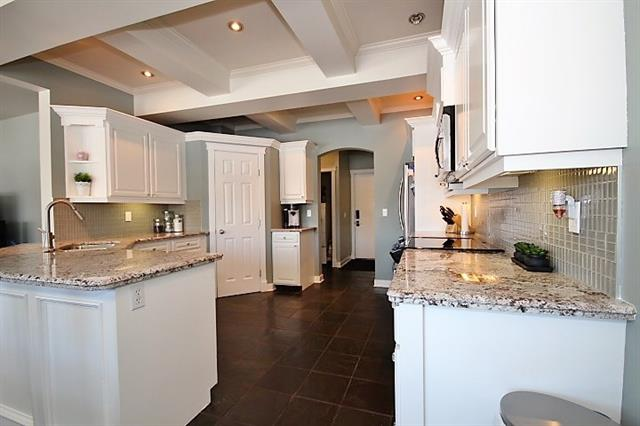 """OPEN HOUSE SAT 1 TO 3:30 PM..PERFECT.Location w/ finished WALKOUT basement backing on to the CANALS.This incredible turnkey,4 brs home awaits YOU & YOUR family.OVER 3000 Sq.ft of living space,9 ft ceilings,main floor mud,laundry rm.Spectacular custom WHITE kitchen cabinetry w/ ARCHITECTURAL design ceilings throughout kitchen & dinning rm area,granite counter-tops,stainless steel package,under cabinet lighting over looking the living rm area w/gas fireplace,3/4"""" width hardwood flooring throughout the main & upper levels.Main flr was just freshly professionally painted.Spacious master BR w/ plenty of rm for a King size bed & rm for 2 dressers,4 pc en-suite and walk in closet,2 generous size brs for the kids, plus a very large BONUS rm w/ built in entertainment center,vaulted ceilings.The inviting lower level also features 9 ft ceilings,a large theater area or rec room w/ 4th bedroom,and upgraded smart strand carpet w/ 10 lb underlay,office,3 pc bath,NEW hot water tank (Jan 2018), A/C."""