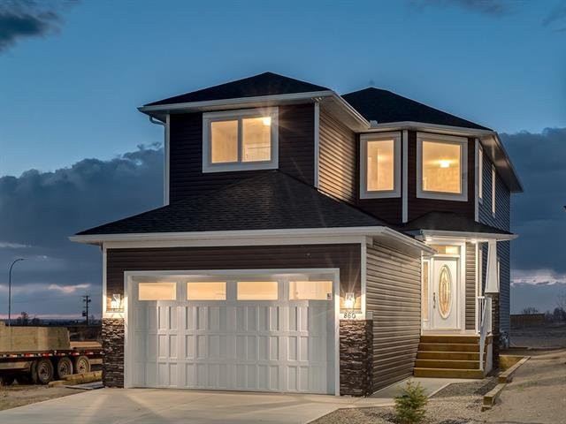 "GORGEOUS NEWER BUILD w/OVER 2042 sq ft of UPGRADED living space, MOUNTAIN VW's, located in the LAKEWOOD Community w/FUTURE LAKESIDE VIEWS + ACCESS just STEPS from the FRONT DOOR! BEAUTIFULLY BUILT home incl 10 YR NATIONAL HOME WARRANTY w/TONS of UPGRADES like, WATER SUPPRESION SYSTEM, LED Lights, KNOCK DOWN + VAULTED CEILINGS w/9? in MAIN + BSMT, 6"" B-Boards, UPGRADED CLOSETS + MORE! GRAND Foyer w/SOARING ceiling, WOOD + METAL Staircase, OPEN CONCEPT Dining + Living rm w/WALL to WALL WINDOWS + access 2 the DECK, CUSTOM BUILT-IN's, COZY Gas F/P w/REMOTE, a STUNNING Kitchen w/GRANITE COUNTERS + B-FAST BAR, GLASS B-SPLASH, DOVE TAILED CABINETS w/SOFT CLOSE Drawers, PANTRY, RECYCLE Drawer, $3000 APPL?s CREDIT,  LRG LAUNDRY rm w/SINK + 2pc bath complete the main! Upstairs feat a DEN, 4pc FAM BATH, 3 GENEROUS Bdrm's w/UPGRADED Closet system, MASTER w/VIEWS of the LAKE, 5pc En suite w/JETT Tub, LRG DUAL vanity + WIC! BONUS FEAT inc: UPGRADED R45 Insulation, ICF Bsmt w/R/I 4 bath, 75 GL H20 tank + PWR HUMIDIFIER!"