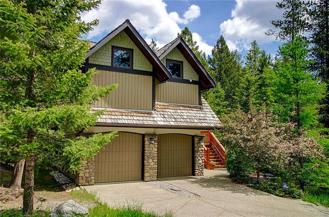 """Located on prestigious Blue Grouse Ridge, in a stunning natural setting, this luxurious, meticulously maintained & selectively upgraded executive home blends modern conveniences & distinctive Canmore charm. On 3 air conditioned levels, all connected by an elevator, the immediate feeling is that this is a truly special property. Under vaulted ceilings, the main living level provides open spaces, both indoors & out, w/ clever architectural features that evoke an environment of intimacy. Rich wood flooring, custom lighting, the finest appliances (including a pizza oven!), a feature fireplace & windows to the mountains and trees say """"this is home"""". A stunning master boasts expansive walk in closets & an ensuite bath w/ steam, soaker tub & dual sinks. Separated for privacy, the 1st level offer 2 more bedrooms, a 2nd bath & family room w/ walkout to the well manicured yard and gardens. A lower level is ideal for guests, w/ sitting room, bedroom and bath. A one of a kind, must see gem."""