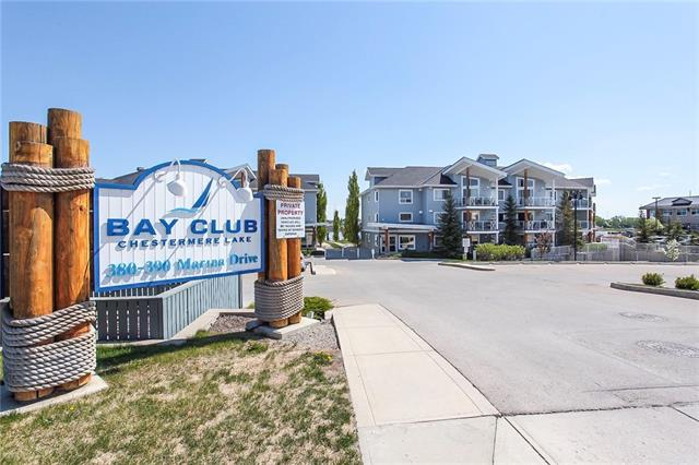 LAKE LIVING AT ITS' FINEST.  Welcome home to this beautiful lake front condo in Chestermere.  This condo has all the space and amenities you need to feel at home.  Enter into the main area with the kitchen on your right, featuring black appliances, slate floors, tons of cupboard space and completed with an eating bar.  To the left you will find a 4 piece bath with a cheater door leading into the spacious master bedroom.  Master also features a walk through closet.  The living room and dining room areas flow together nicely with lots of space for yourself and guests.  Also enjoy the convenience of in-suite laundry.  Head out to the balcony for a partial view of the lake and full view of the City of Chestermere.  Located on the 2nd floor, this building is complete with a fitness room on the 3rd floor and a recreation/meeting room on the 2nd floor.  Take comfort in the secured heated underground parking.  Enjoy the lake access and beautiful walkways that surround the buildings.