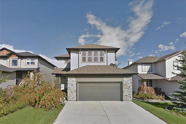 COME VIEW THE 3D TOUR for this great 2 storey home, in super popular Westmount, that?s close to local schools & the best of Okotoks? shopping. Beyond the covered front porch, is the bright & spacious entrance with elegant display shelves. Note the 9ft ceilings & hardwood floors. To the rear is the living room with a cozy gas fireplace. The kitchen is a delight with masses of granite countertops & a large island featuring a breakfast bar. The large dining area features huge, double aspect windows & an upgraded chandelier light fixture, as well as a door out to your rear deck. The laundry room & 2-pc washroom complete this level of the home. Upstairs, the master bedroom has a 5-pc en-suite & a large walk-in closet, whilst bedrooms 2 & 3 share the family bathroom. The bonus room is huge & has lots of windows for natural light. The basement features a spacious living/recreation room, a bathroom & a storage room. You?ll love the large, private, fully fenced yard, with its low maintenance deck. Great value!