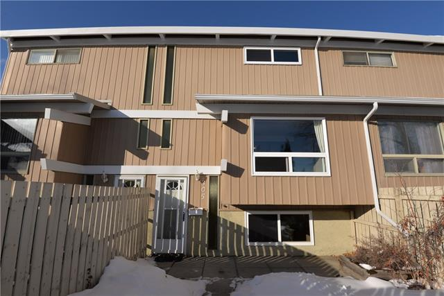 Here's a great opportunity for first time home buyers to own a large unit with private fenced yard with a storage shed. 3 bedrooms, 1.5 bathrooms, parking stall, and a bright and open kitchen with lots of cabinet space.  New windows and new S/S appliances - stove, refrigerator, dishwasher. Property is located across from Southcentre mall with c-train station close by. A must to view this unit.  Priced to sell!