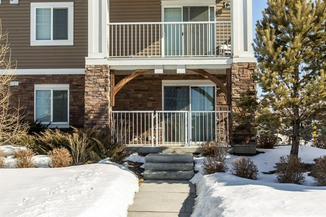 OPEN HOUSE SAT MAY 19, 1-4 PM. This is a gorgeous ground floor unit with 2 beds/2baths. Best of both worlds - The master bedroom has a walk-in shower and the main bath has a tub and shower. This location is amazing - a corner unit letting in lots of sunlight with the shopping centre (including Sobey's, Pet Planet & Good Earth) just steps away. Also quick and easy access to deerfoot trail.  An underground stall is included for your convenience and your visitors can park on Cranston Road and meet you at your patio entrance! This unit is immaculate with lovely, hardy laminate flooring throughout, and stainless steel appliances. This is an amazing complex, Built by superior Cardel Lifestyles. it is pet friendly with Board approval.