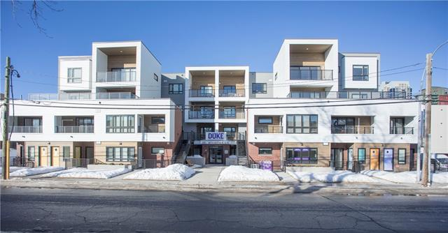 """Please click on """"Multimedia"""" for 3D tour!  Brand spankin' new 2 bed / 2 bath condo in an unbeatable location, built by one of the top builders in the city! Features include: 9ft ceilings, quartz countertops throughout, high end SS appliances including GAS stove, cool under cabinet lighting in kitchen & bathrooms, WEST facing patio to enjoy the sunshine (with BBQ gas line), in suite laundry (washer & dryer included!), 1 titled parking space, 1 assigned storage locker, soft close cabinets & drawers, modern ceramic tile, oversized shower, stylish square bathroom sinks & much more! I cannot say enough about the location - WITHIN 1-3 BLOCKS: all the remarkable restaurants & shopping on 17th Ave, Talisman/Repsol Sport Center, Elbow River & extensive walking paths, Saddledome/Stampede Park & LRT station. Downtown is a short 5 min walk! This fabulous home even comes with a 1 year bumper to bumper warranty through Avi Urban!  Comes see it today - you will not be disappointed!"""